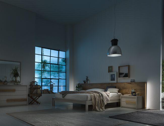 camera moderna con letto particolare in legno naturale