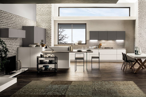 cucina e soggiorno open space con isola che divide Mod Atlanta e Dakota da Paola Elisa Mobili
